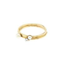 Three gold pearl rings